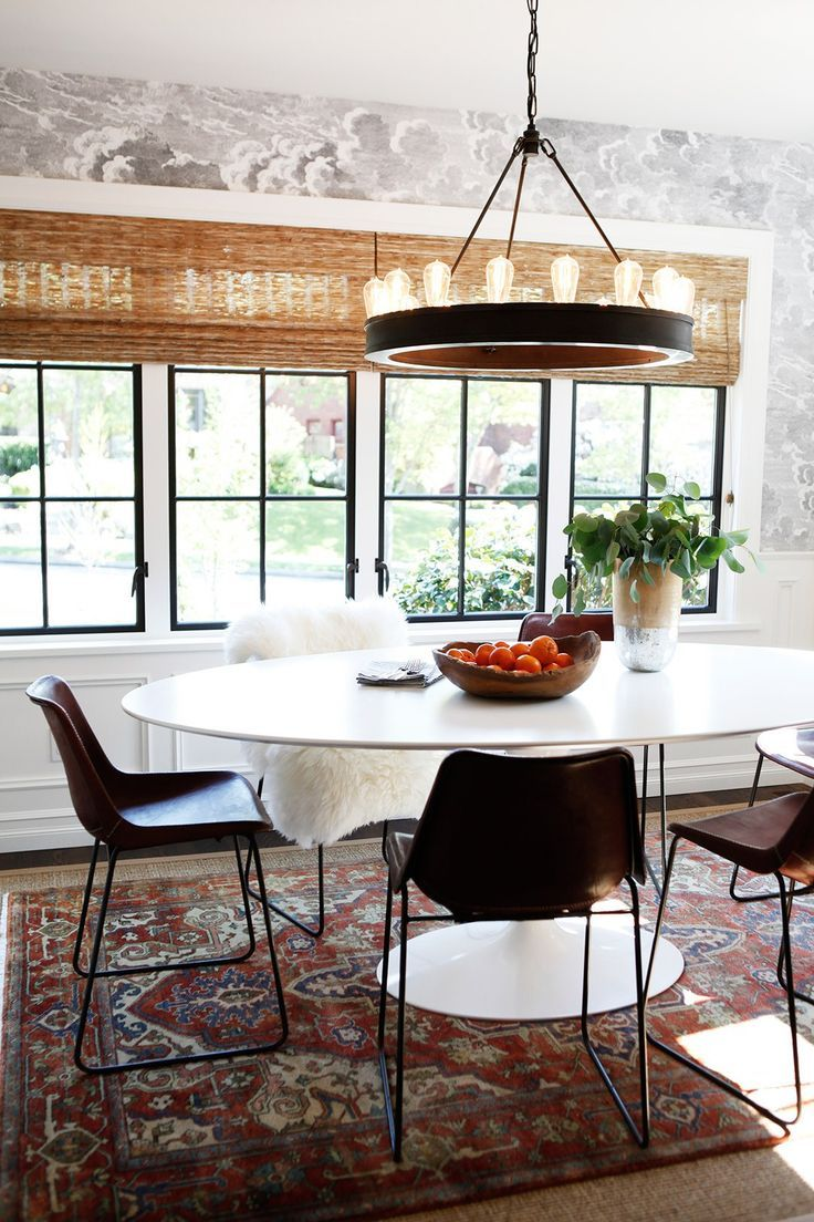 Eclectic dining room design featuring black and
