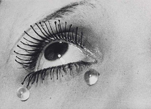 Tears (1933), Man Ray.Like a film still from a silent movie, this work reeks of drama: what has happened to cause this woman such distress? Glancing upwards wistfully, her eyelashes are mascara-encrusted, her tears unnaturally spherical. This is not a real woman; it is a mannequin, crying tears of round glass beads. Man Ray's inspiration for this gelatine silver print may have been his recent breakup with fashion photographer Lee Miller.