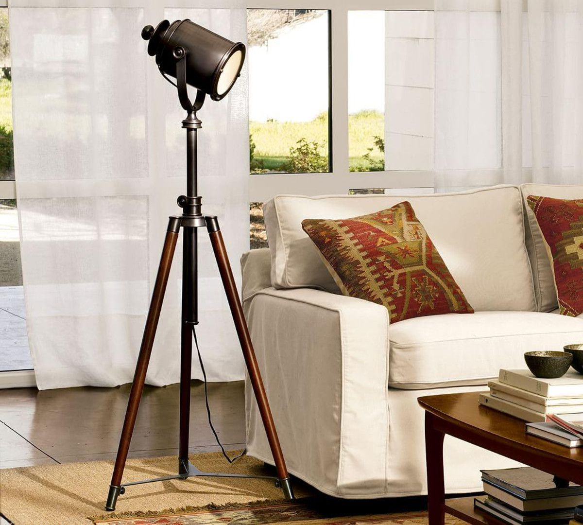 Tripod floor lamp in living room - Photographer S Tripod Floor Lamp From Pottery Barn Maybe For The Useless Corner Of Our Living Room