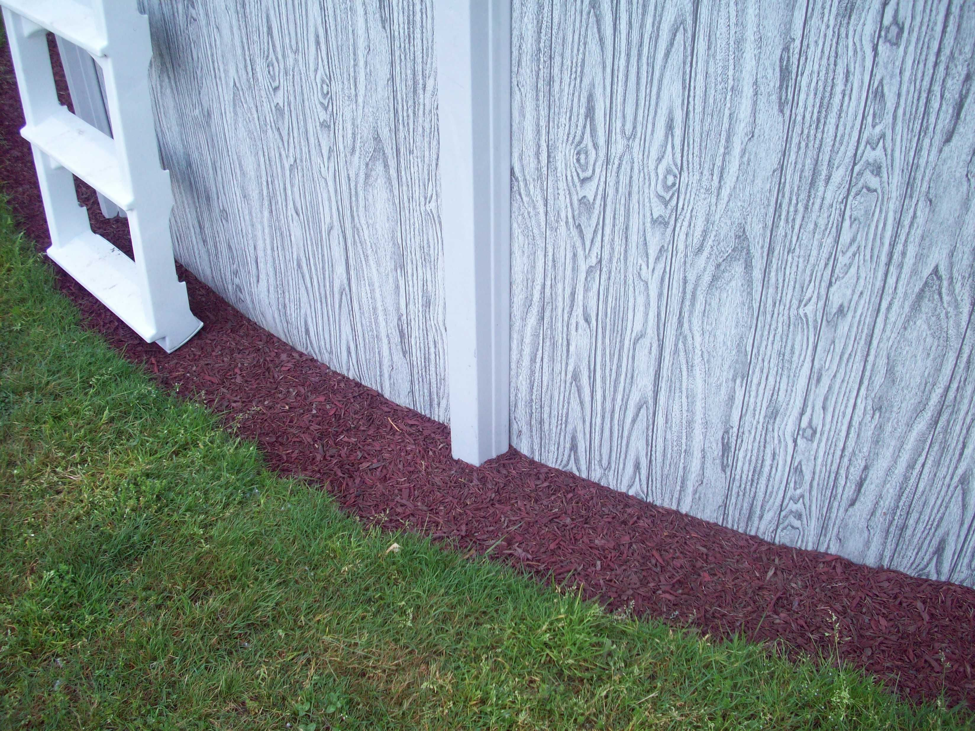 Landscaping project rubber mulch ground pools and backyard for Pool garden edging