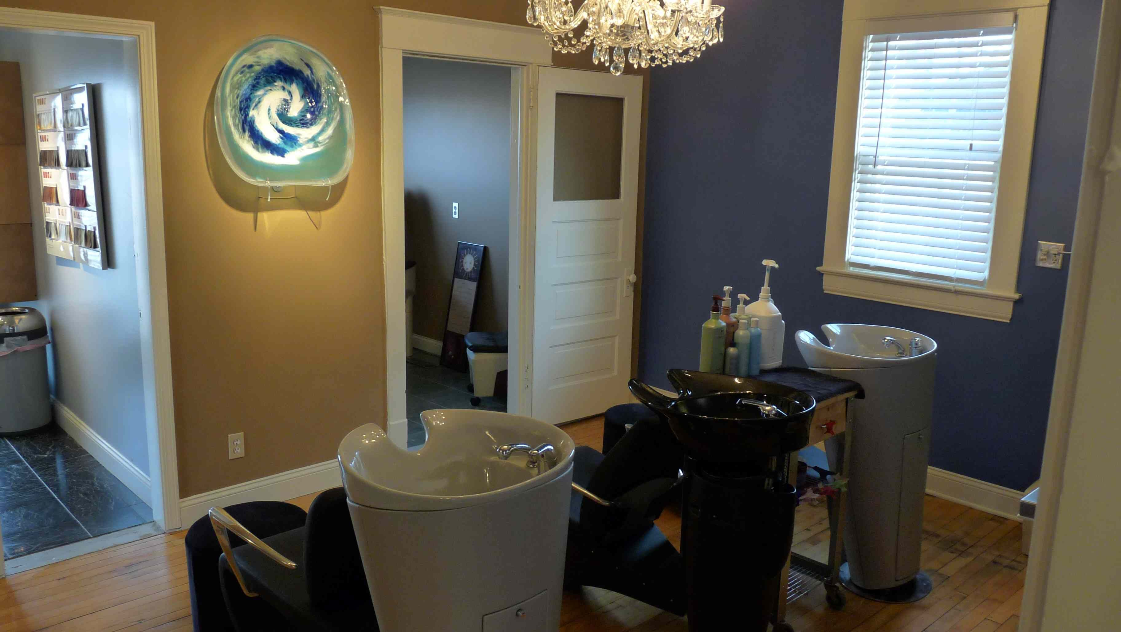 Shampoo room looking into pedicure room and color station