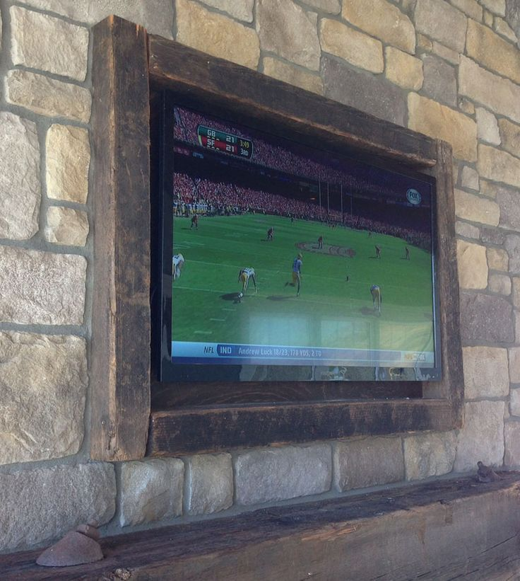 DIY TV Frame - love the way it\'s built into the stone ...