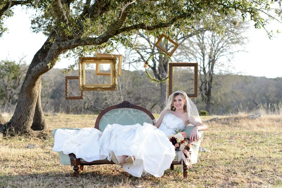 Weddings l Kristin is stunning on this vintage couch at CW Hill Country Ranch