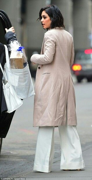 Trendy and terrific: The star looked incredible in a long white suit and baby pink coat