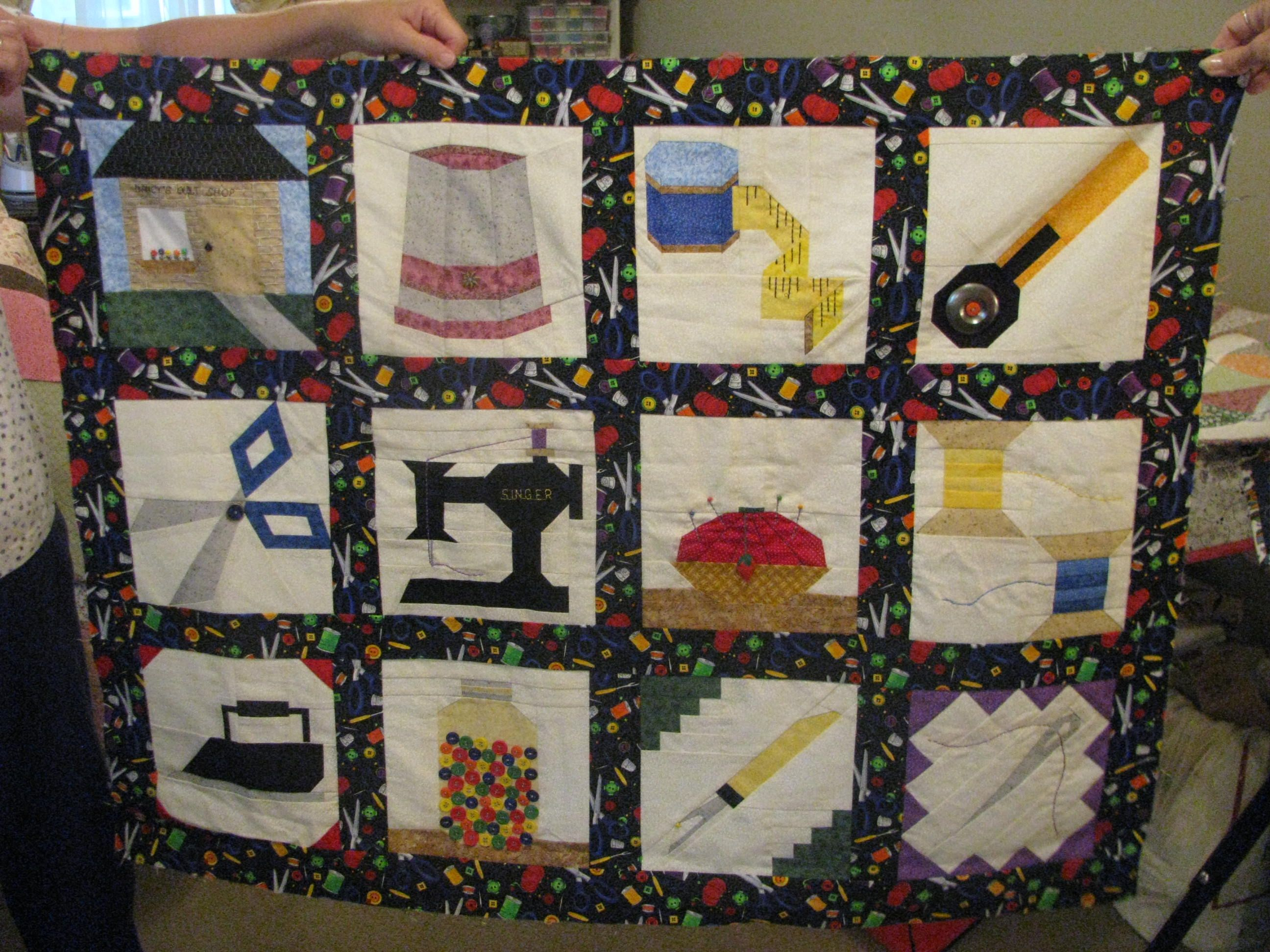 Sewing quilt made by Nancy.  Must be nice to be so talented!!!!!  That is just TOO CUTE!!!!