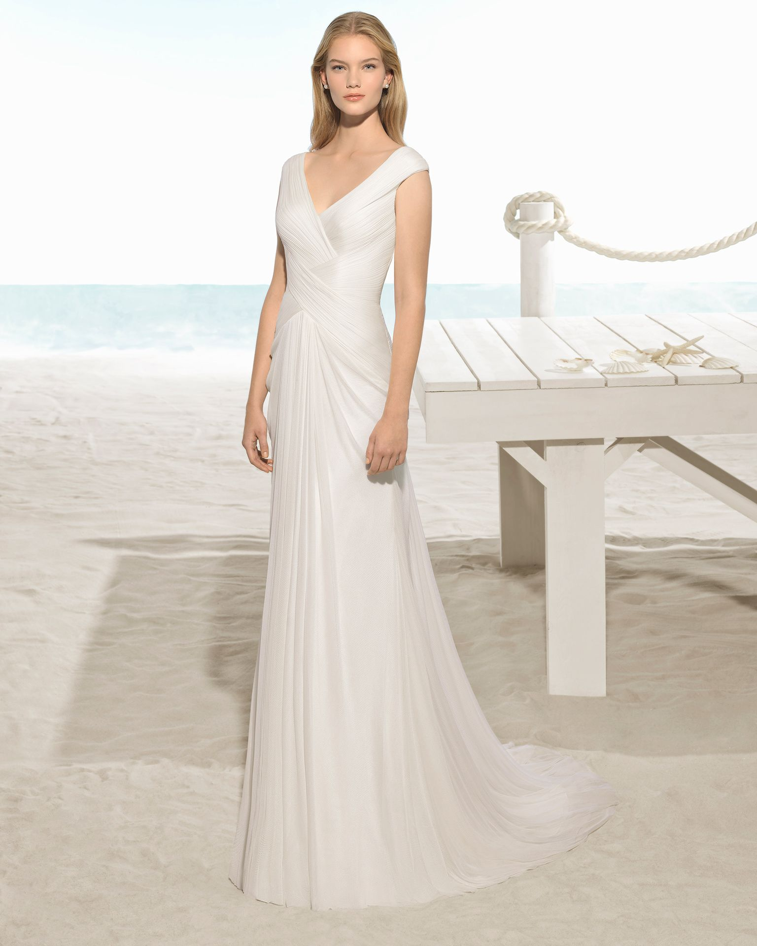 Bohostyle silk mousseline wedding dress with crossover neckline and