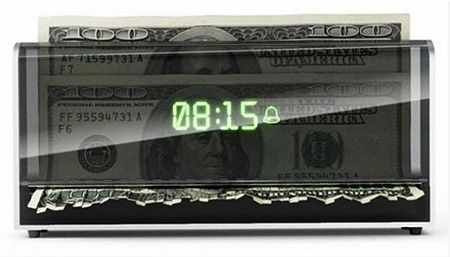 """You know what they say, """"time is money"""". The """"Shredder Clock"""" wants to ensure that none of your time is wasted, as it will begin shredding whatever currency you put in, if the alarm does not get manually shut off immediately -- you won't find a snooze button on this thing."""