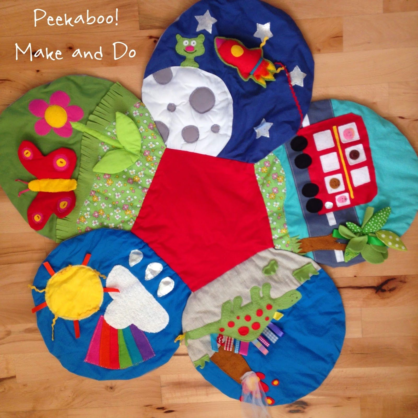 A baby sensoryplay matlots of detail colour textures