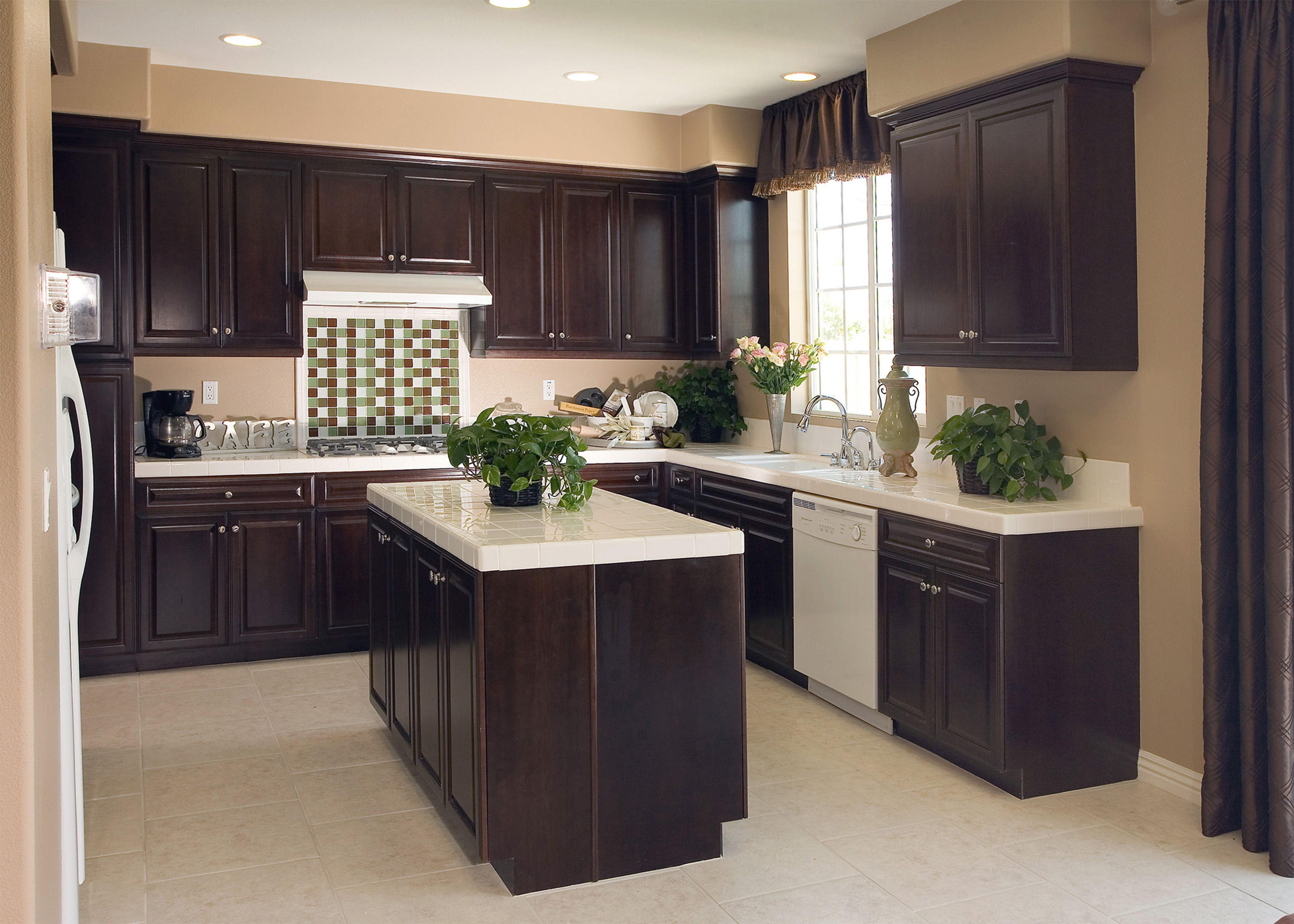 picture of u shaped apartment kitchen with dark brown wooden cabinet