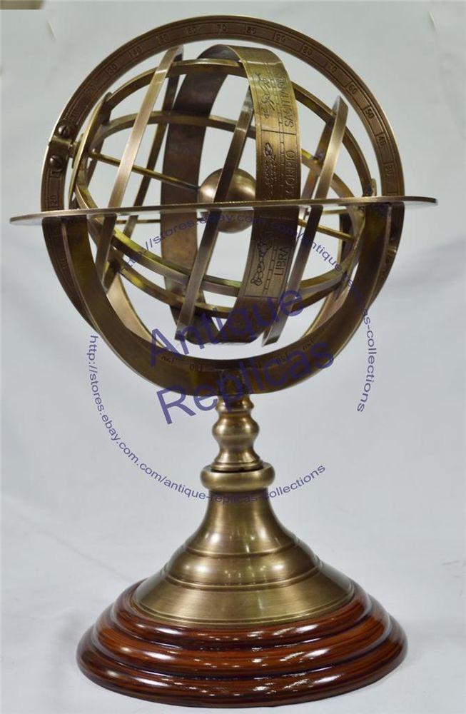 http://www.ebay.com/itm/Buy-Brass-Antique-Armilliary-Sphere-Replica-on-Wooden-Base-Nautical-Decor-Globe-/201056932217?pt=LH_DefaultDomain_0&hash=item2ecfed5179