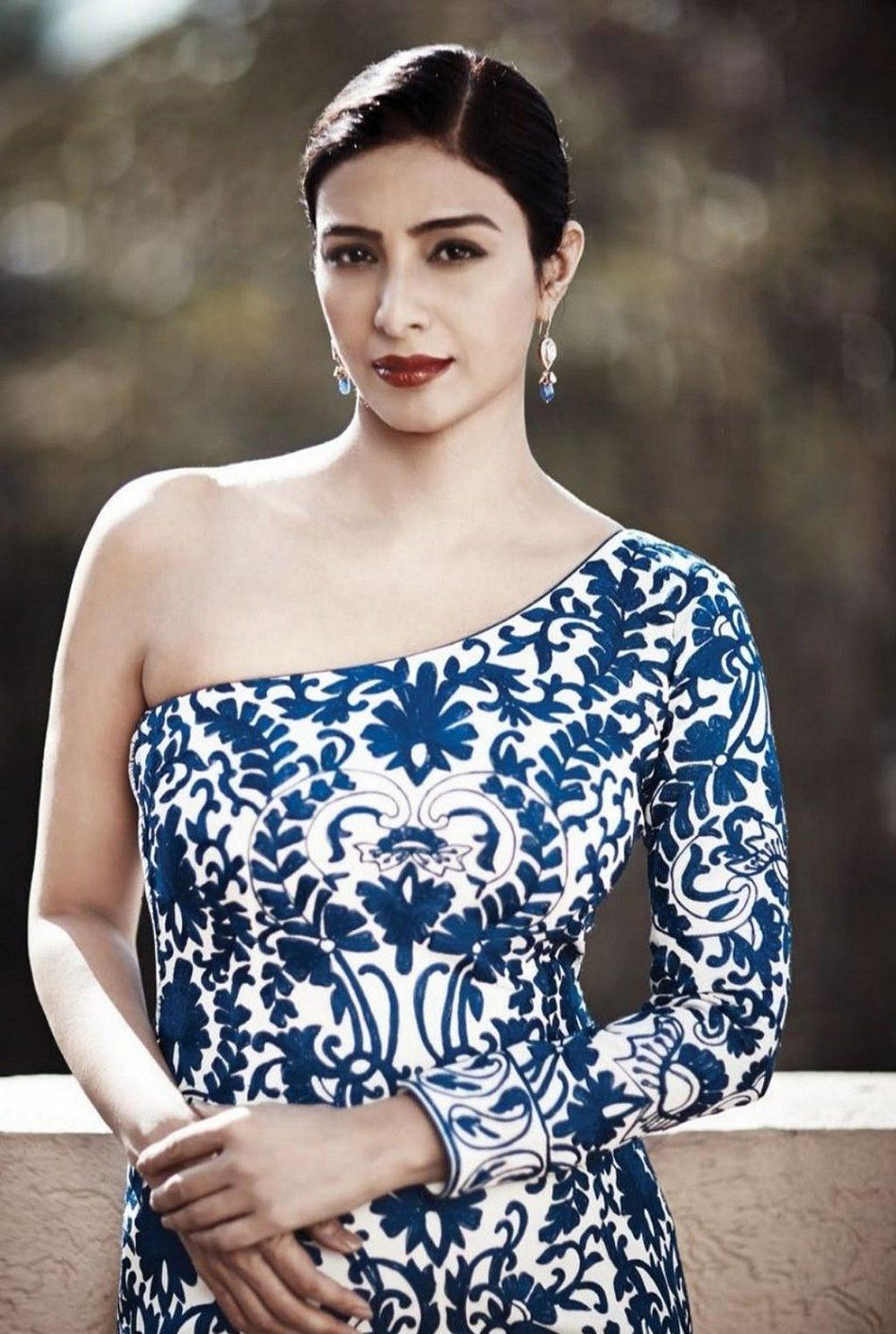 Tabu With A Slick Low Bun Hairstyle Fit For A Sophisticated Look
