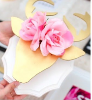 To recreate this d.i.y. you will need a wooden plank from Michaels / a small jar /a large stencil / spray paint / and flowers.  To start off get your stencil and wooden plank ,spray paint it (this step is optional). After that has dried and you're ready, glue down the stencil to the small jar for a 3-D effect. Then glue down the stencil and small jar to the wooden plank after that whole thing has dried hot glue the flowers to the stencil after cutting off the stem.