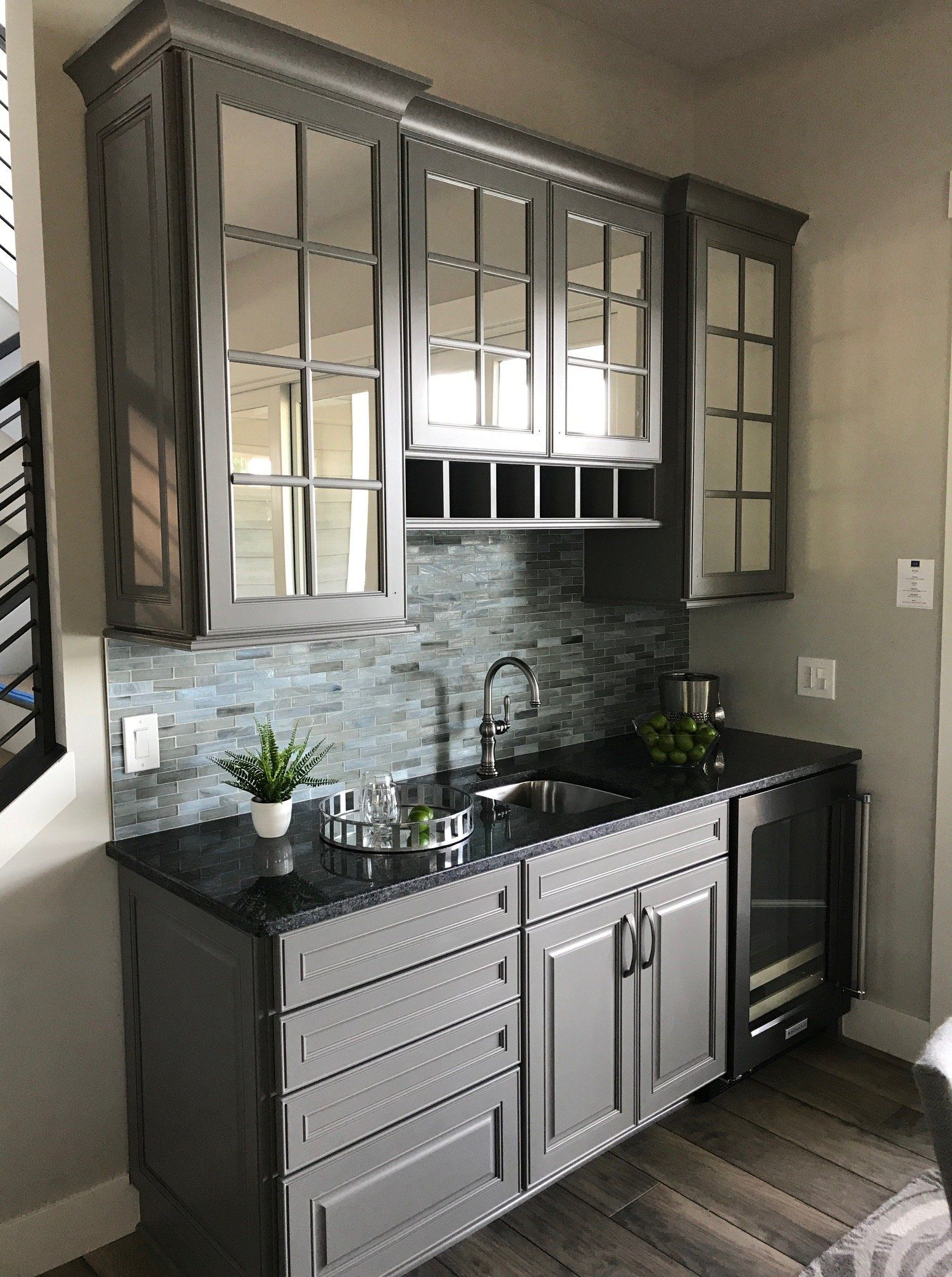 A Kitchen Wet Bar Featuring Gray Washed Cabinets In 2020 Kitchen Wet Bar Kitchen Black Counter Wet Bar Cabinets