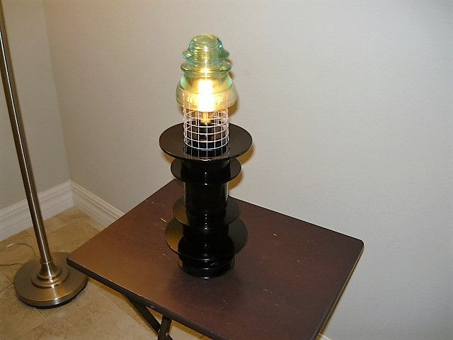 Table lamp made from used motorcycle and industrial parts also table lamp made from used motorcycle and industrial parts also uses a vintage electrical insulator mozeypictures Image collections