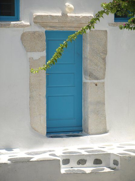 We love the stark blue colour of this painted door against the white-washed villa walls. Renting a holiday villa in Mykonos means you have a great base from which to explore the island in Greece.