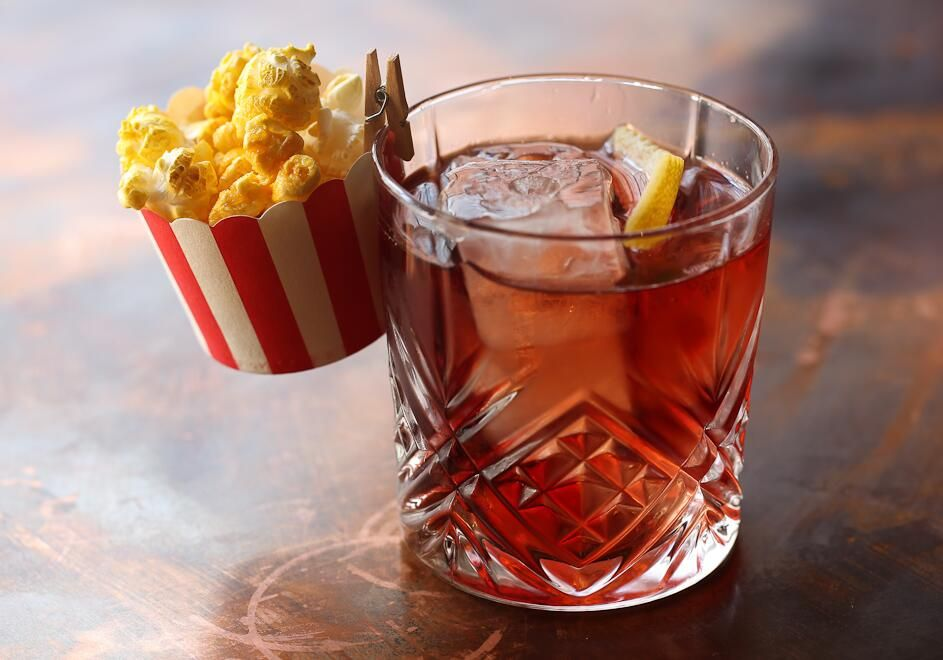 The Silver Screen cocktail with popcorn-infused Buffalo Trace bourbon, cherry…