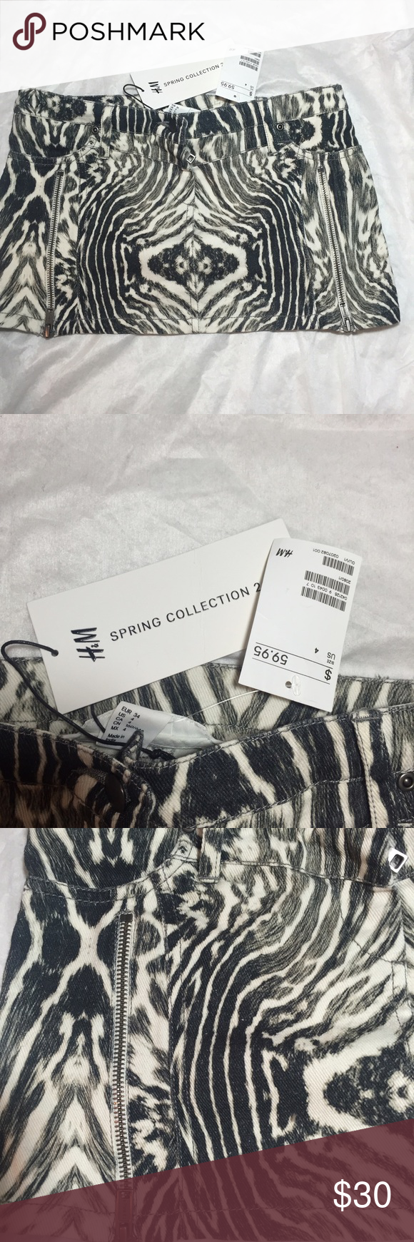 H&M Spring Collection B&W Animal Print Denim Skirt This is a NWT H&M printed denim skirt from the spring collection and it is a flawless piece! It has a zipper on each side that adds a nice subtle style flair perfect for anyone's style whether you are more simplistic or like to be the center or attention! H&M Skirts Mini