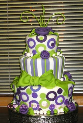 Green and white fondant four tier wedding cake with purple and white ...