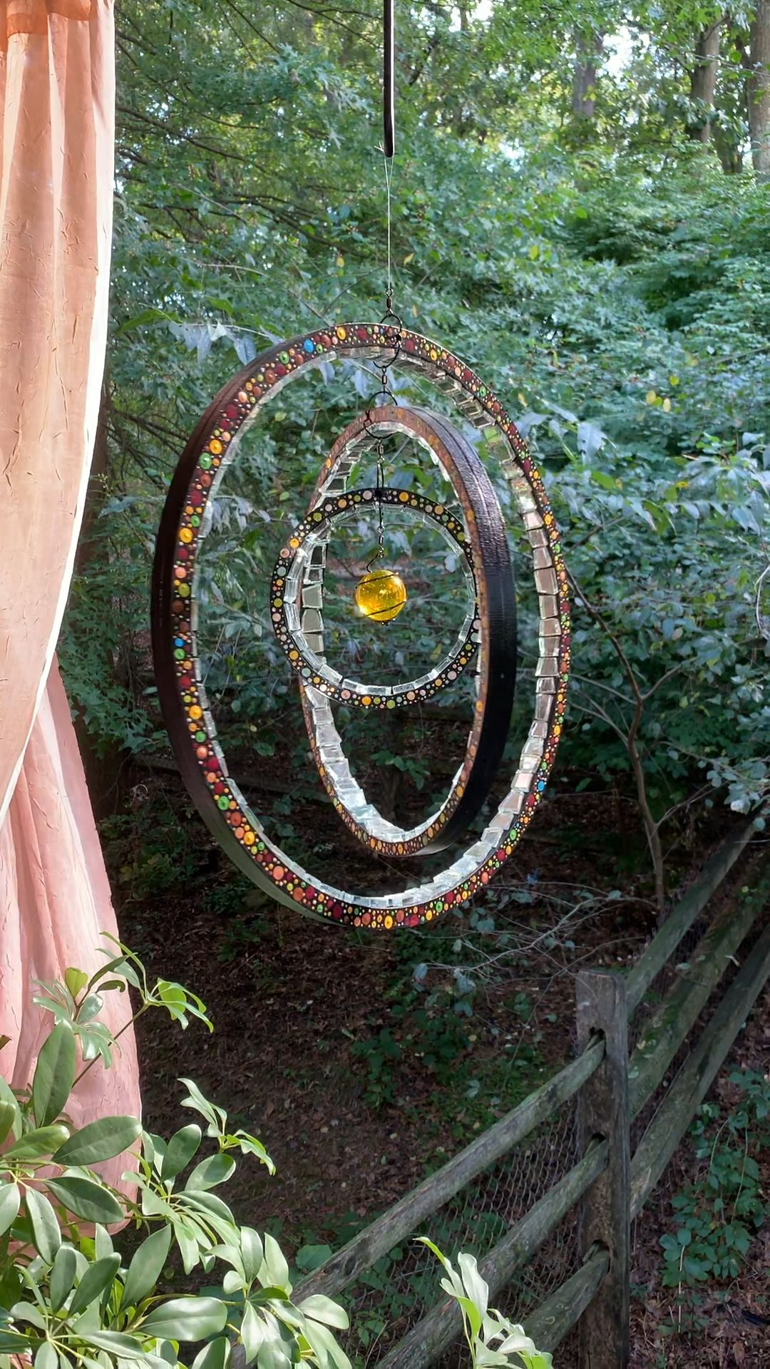 Indoor outdoor garden decoration..enhances a lighted space and lifts the energy. Mosaic design with mirror tiles on hand painted wooden circles that add color and light in a unique style.  #gardendecor #mosaicart #bohemiandecor #bohostyle