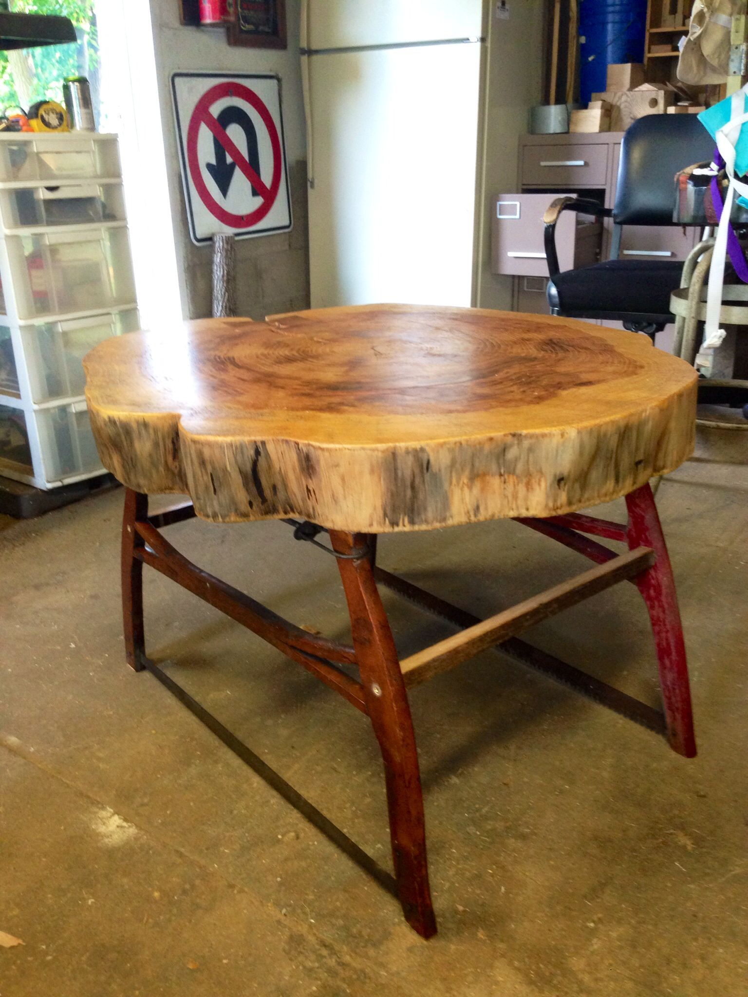 coffee table white pine slab with salvaged bow saw legs foreman