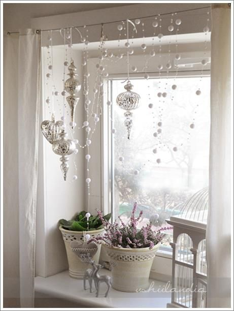 "I love this window display :: Cotton snowballs threaded on ""clear wires"" suspended from rod across window ..."
