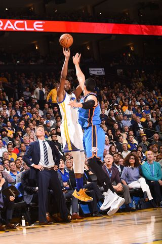 Oakland California -- Kevin Durant and the Golden State Warriors  power to 122-96 win over his former team Oklahoma City Thunder on Tuesday, November 3, 2016.