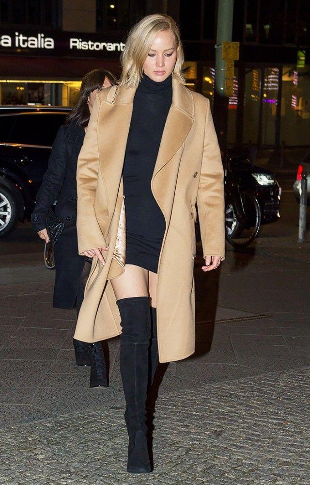 6c9482de34f0e Jennifer Lawrence wears a black mini dress, camel coat, and suede thigh-high  boots