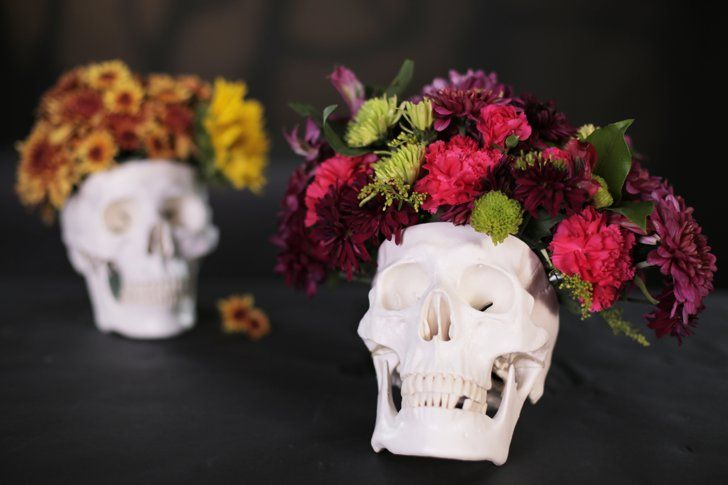 Pin for Later: Here's How to DIY the Most Stylish Halloween Crafts You've Ever Seen Skull Step-by-step guide: DIY Skull Floral Centerpiece
