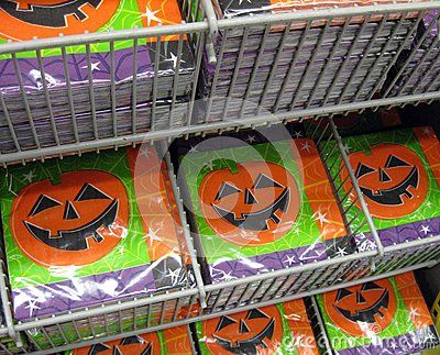 A rack containing packages of paper serviettes for a Hallowe'en party.