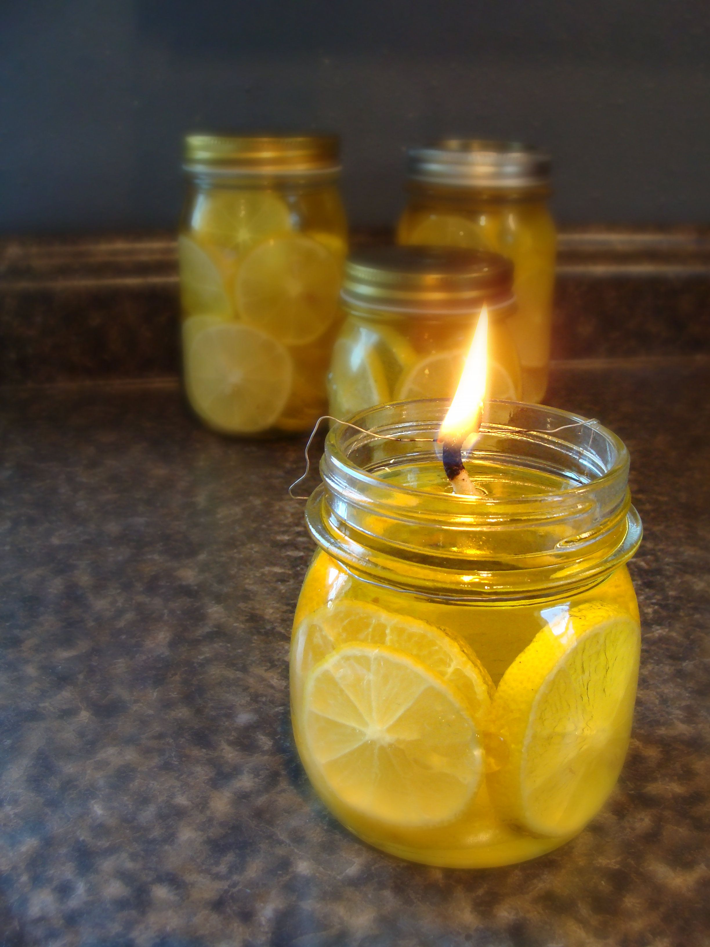 Lemon Filled Olive Oil Lanterns In 2020 Oil Lantern Diy Mason Jar Candles Oil Candles