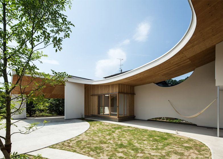 Y+M Design Office's Shawl House has a roof that shelters a tea room