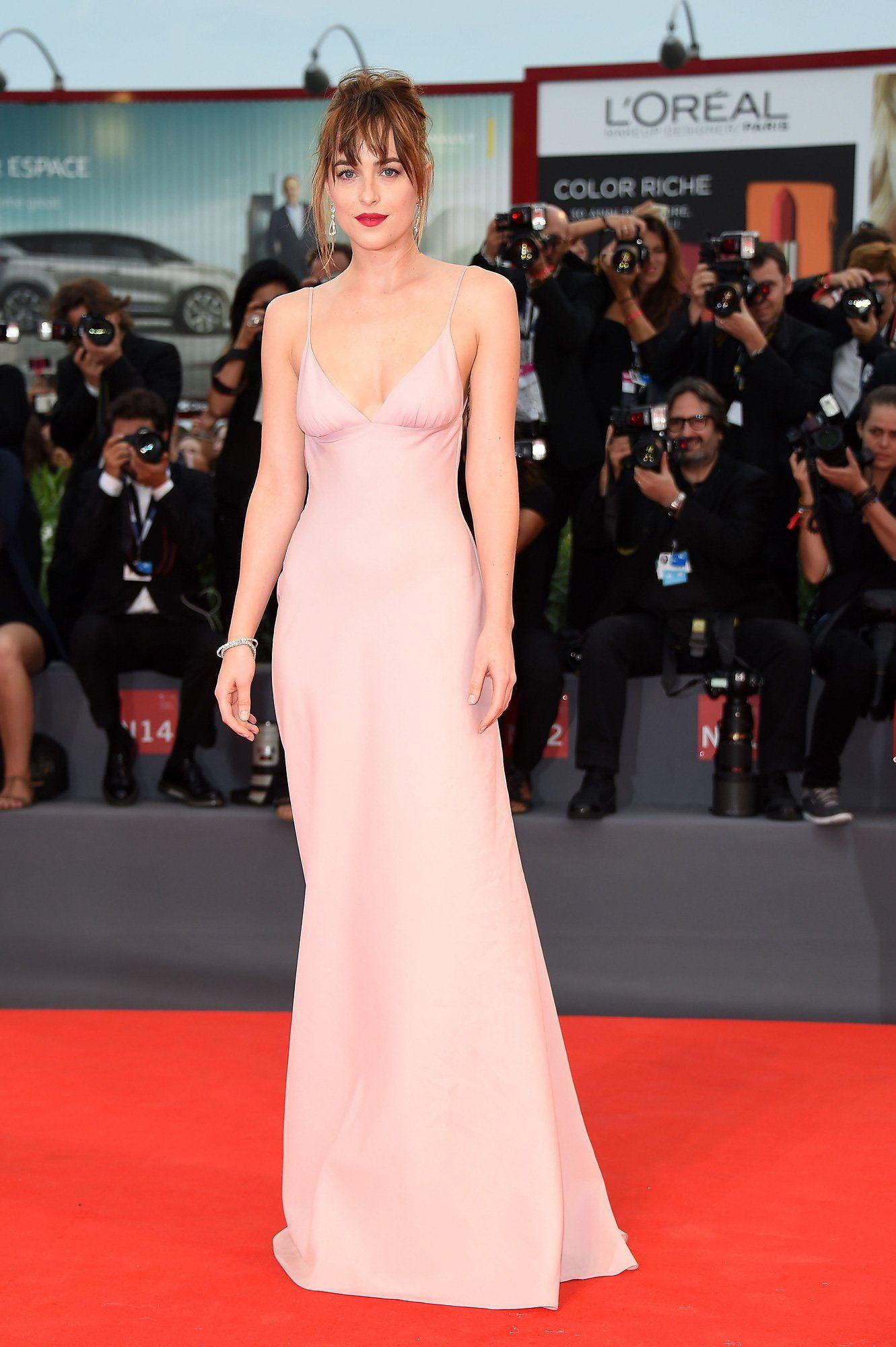 1f5bd97f0a WHO  Dakota Johnson WHAT  Prada WHERE  Venice Film Festival