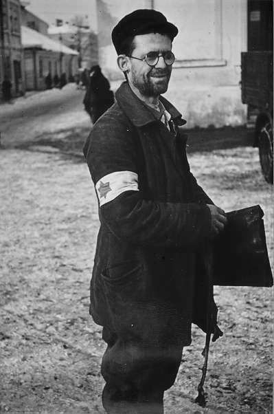 Jewish man standing in a concentration camp. | Star of ...