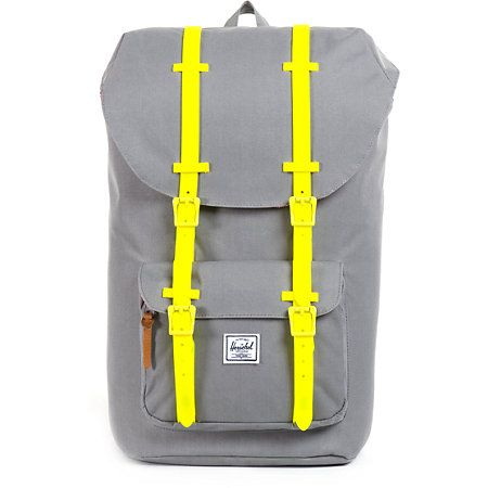 like a perfect match - This all grey Herschel Little America backpack will add some flavor to your back to school expeditions like modern functionality, old school design, heavy duty weather resistant neon green rubber front straps with magnetic closure, main compartment cinch top closure, and lined with Herschel's signature coated cotton-poly fabric throughout.