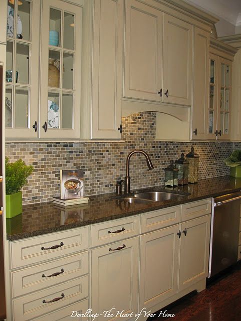 Backsplash love this could still keep cabinets just add - Black granite countertops with cream cabinets ...