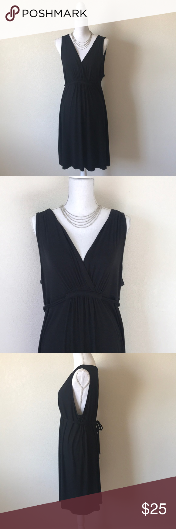 Ann Taylor black sleeveless dress Adorable black knit dress in excellent condition. Very soft and stretchy. Plunging v-neckline, gathering through the waist and ties in the back.  95% Rayon, 6% Spandex Ann Taylor Dresses #blacksleevelessdress