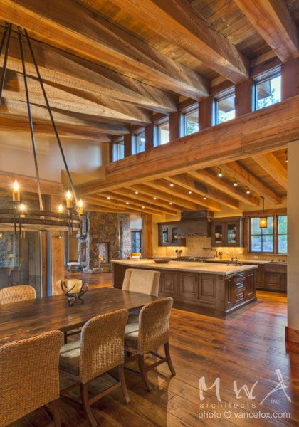 Exposed Heavy Timber Beams With Wood Ceiling At High And Low Shed