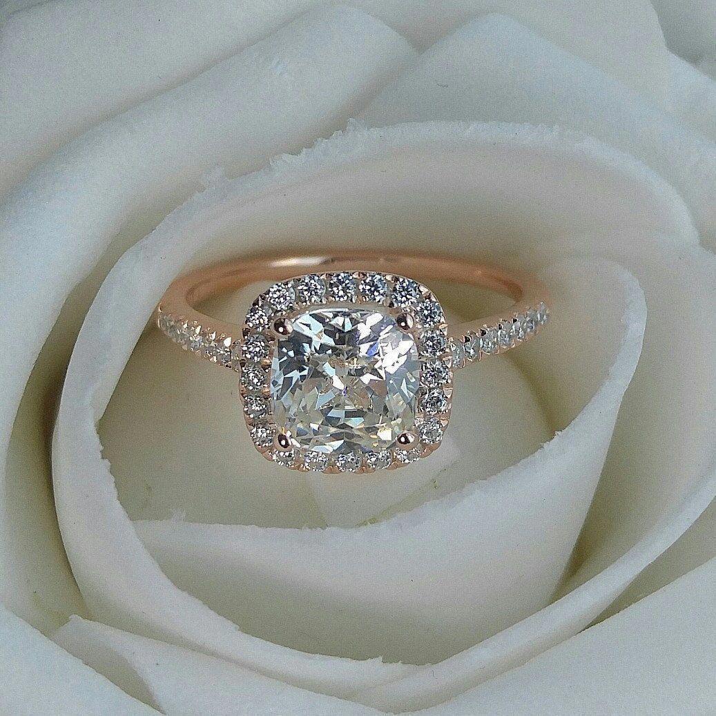 2 carat cushion cut halo engagement. Custom made as rose gold plated.  Beautiful! 6e1a27ca5f