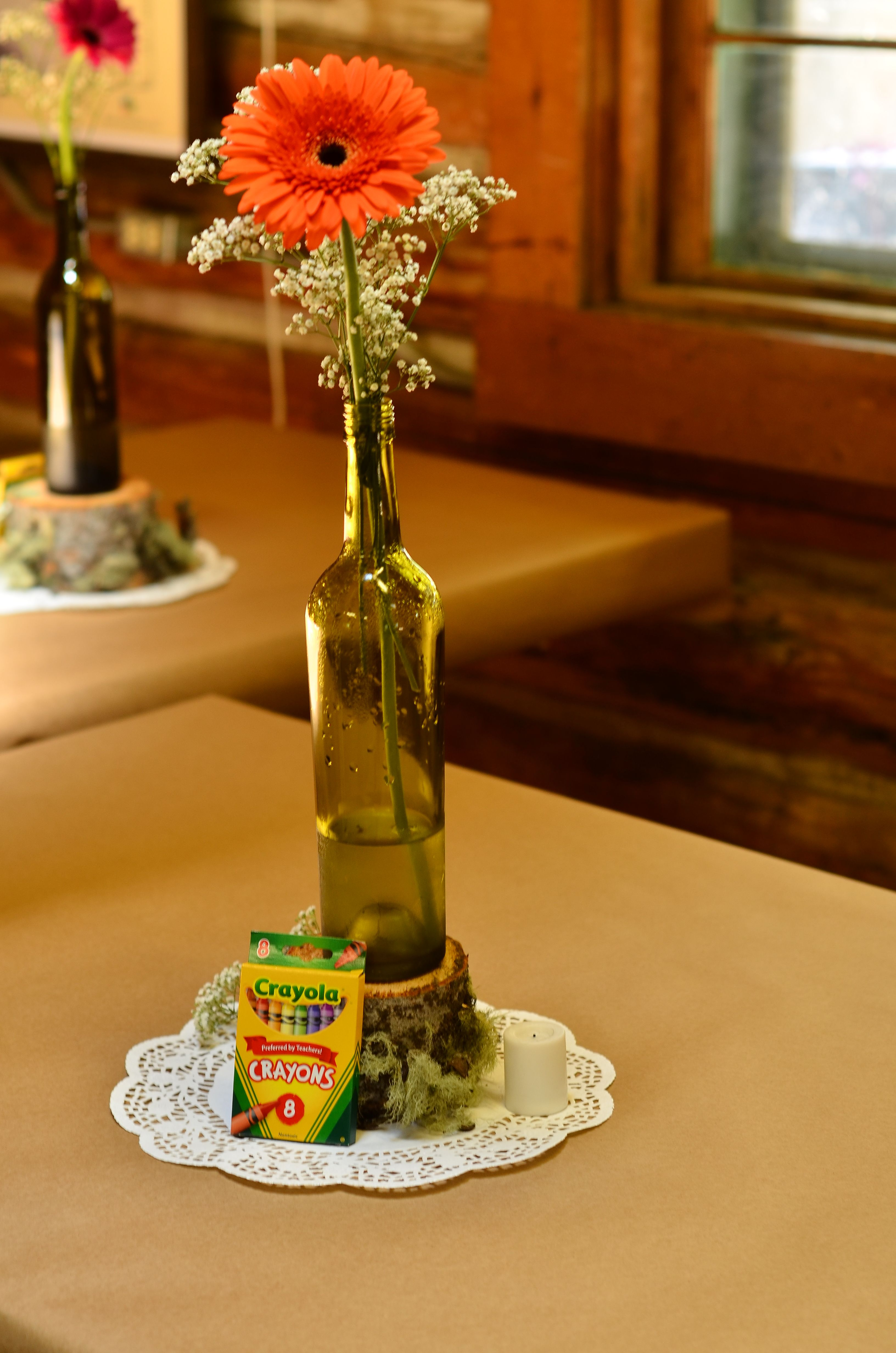 Simple gerbera daisy and babys breath in a wine bottle made an reception simple gerbera daisy and babys breath in a wine bottle made an elegant statement along junglespirit Gallery