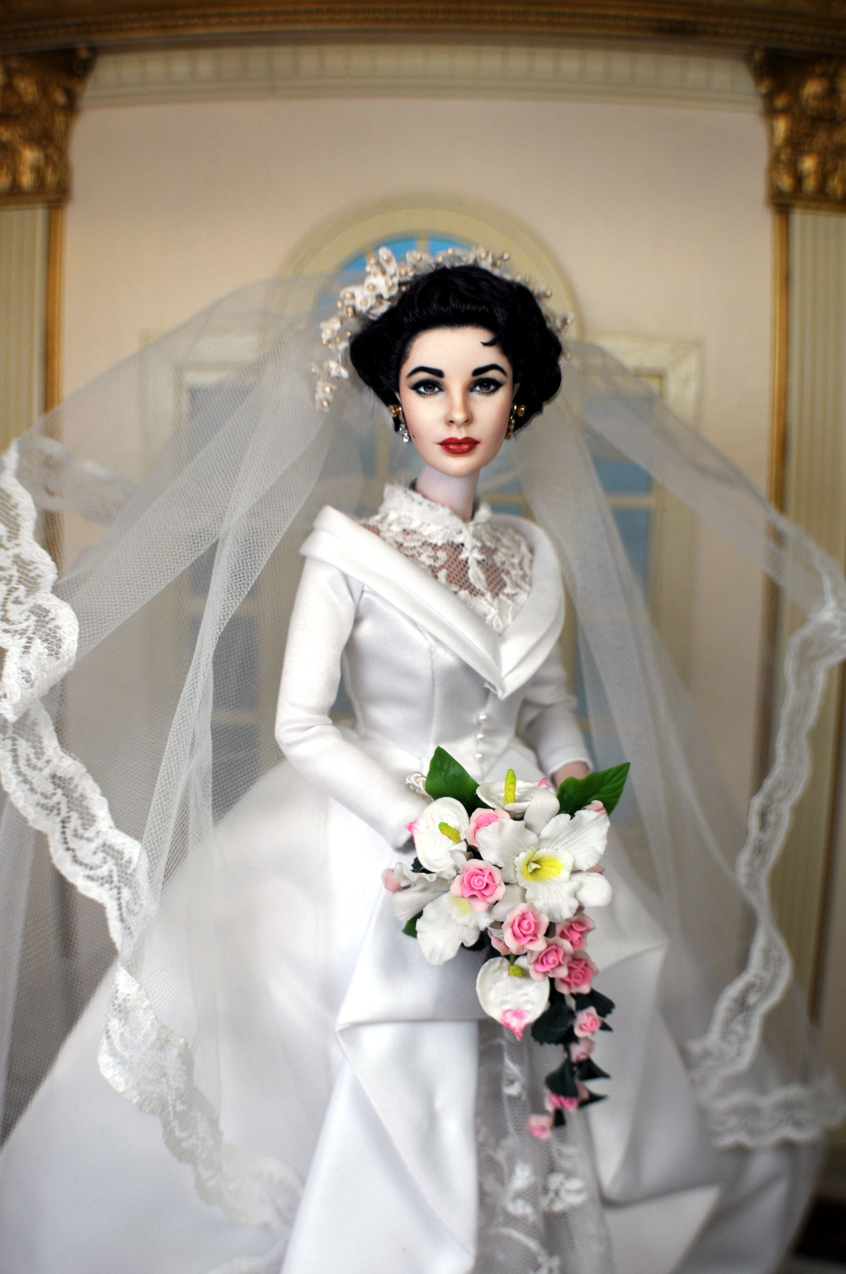 Repainted and restyled Elizabeth Taylor Barbie in the Mattel Father of the Bride Wedding Gown. Redone by Noel Cruz. See his site at http://www.ncruz.com for more of his work and visit flickr at https://www.flickr.com/photos/farrahf/ for more photos.