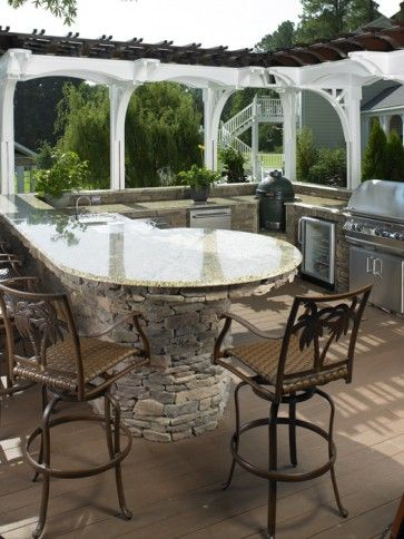 outdoor kitchen with granite counter tops, bar, grill and natural