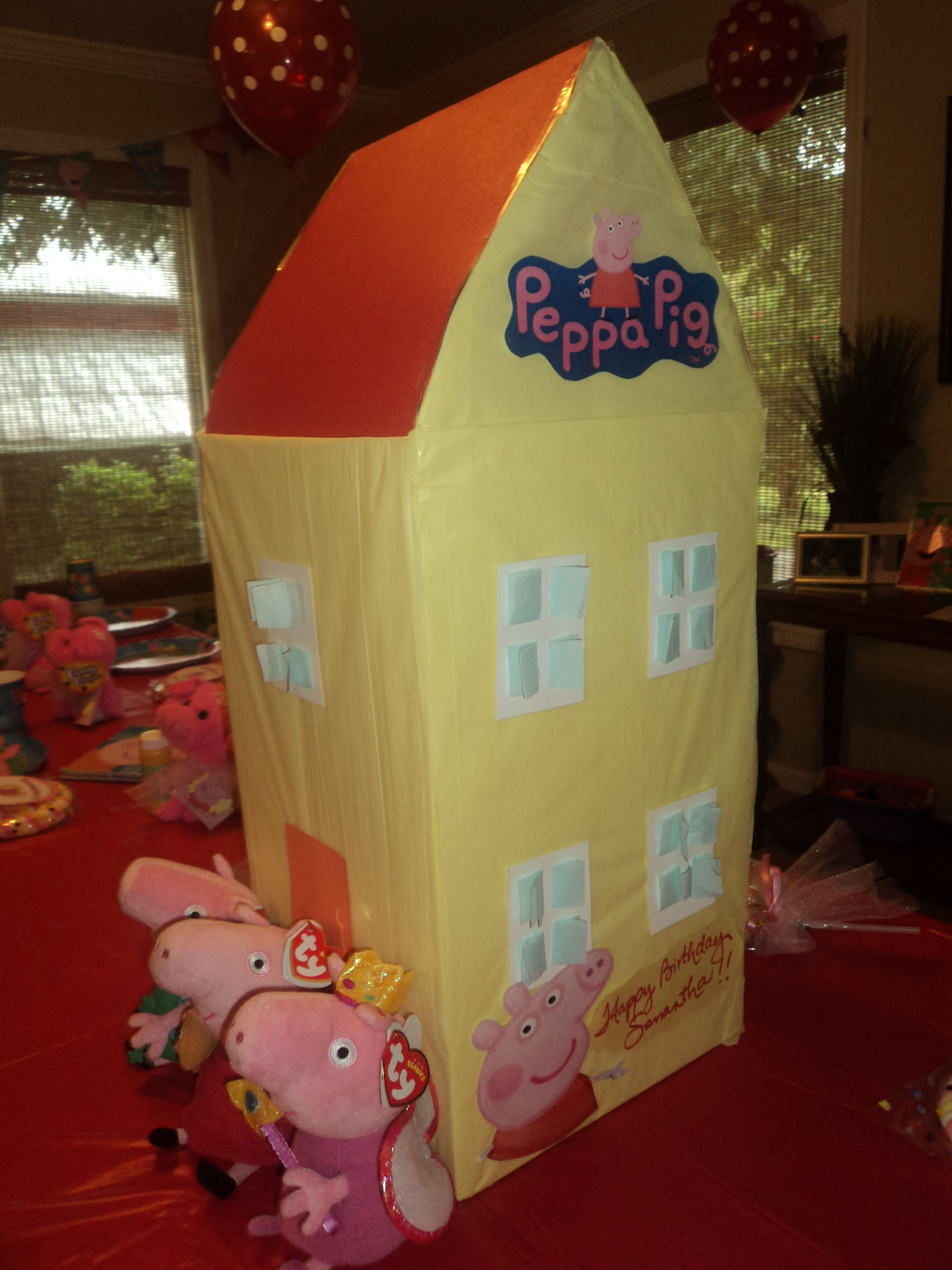 peppa house made out of cardboard box, some cardboard paper and tissue paper. cutouts to complete it and personalize it.