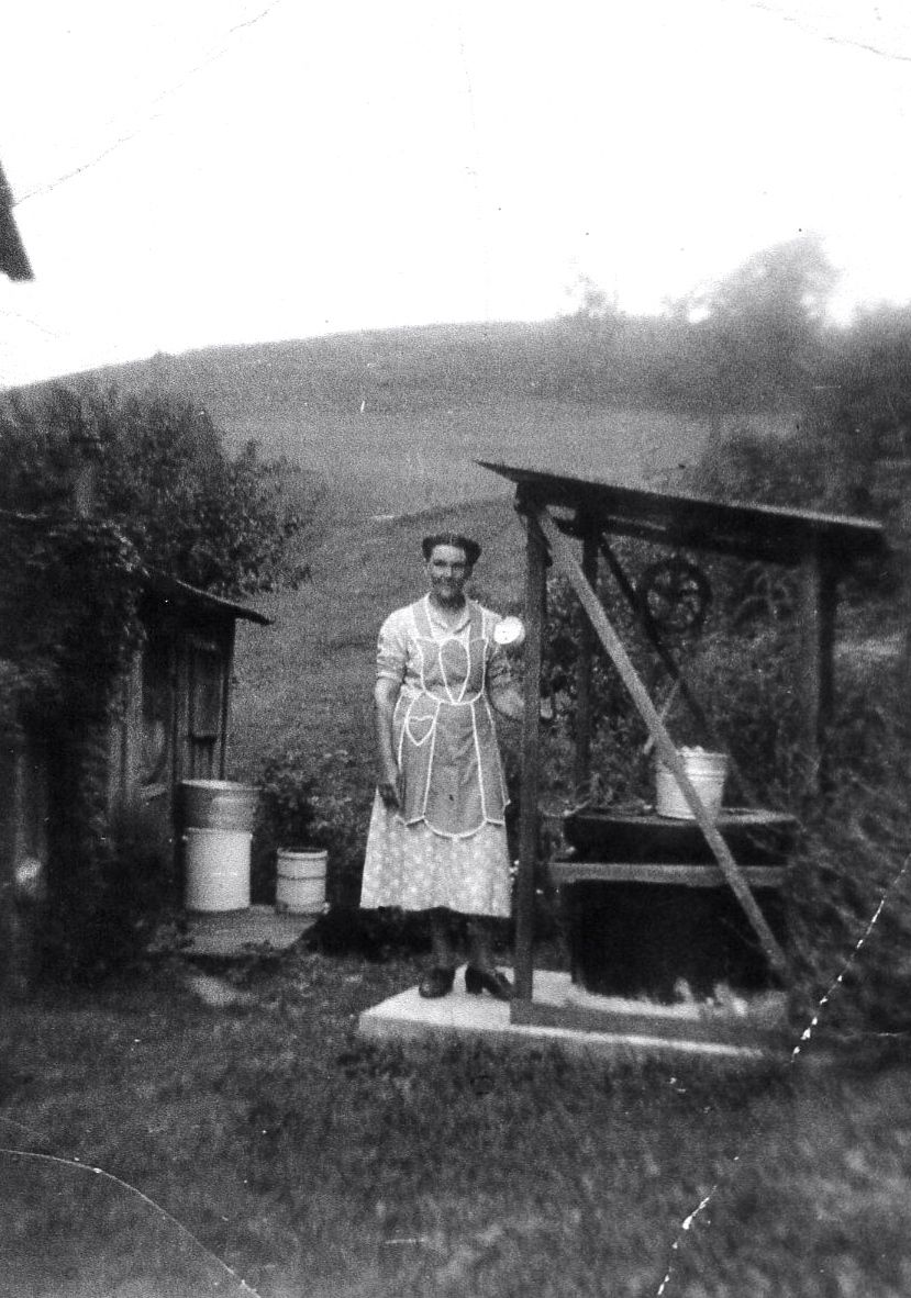 Water at the well roane county west virginia ca 1918