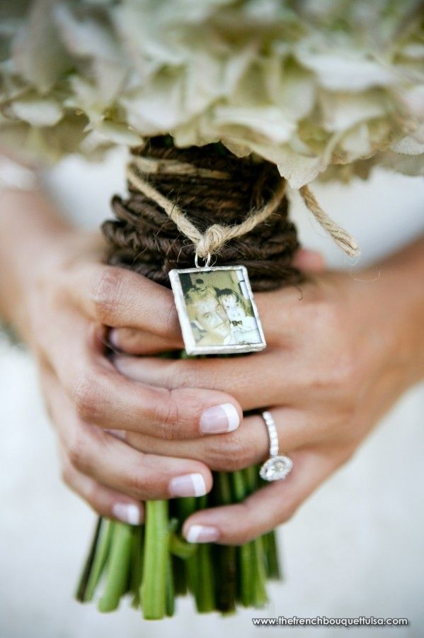 personal photo charm attached to bridal bouquet later can be made into an ornament or