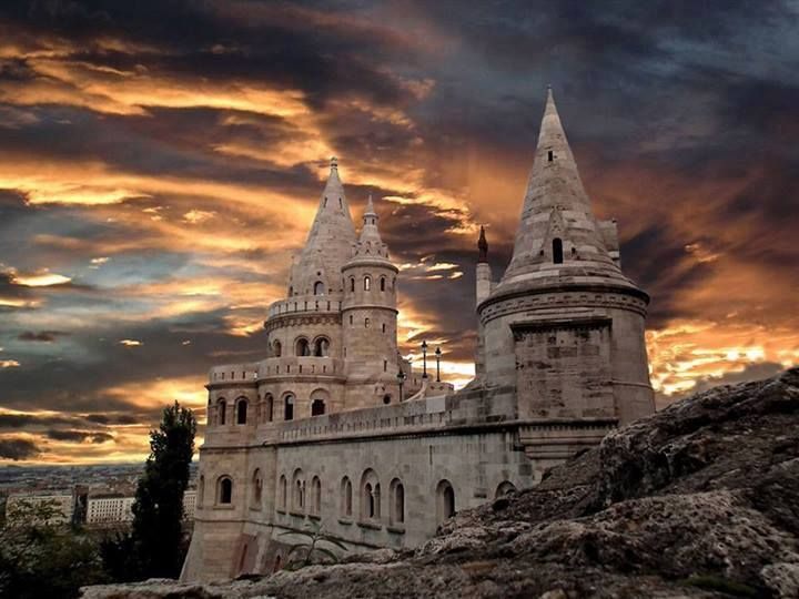 Fisherman's Bastion, Budapest, Hungary. The Halászbástya or Fisherman's Bastion is a terrace in neo-Gothic and neo-Romanesque style situated on the Buda bank of the Danube, on the Castle hill in Budapest, around Matthias Church. It was designed and built between 1895 and 1902 on the plans of Frigyes Schulek. From the towers and the terrace a panoramic view exists of Danube, Margaret Island, Pest to the east and the Gellért Hill. Follow AmiPlanet on pinterest.com/...