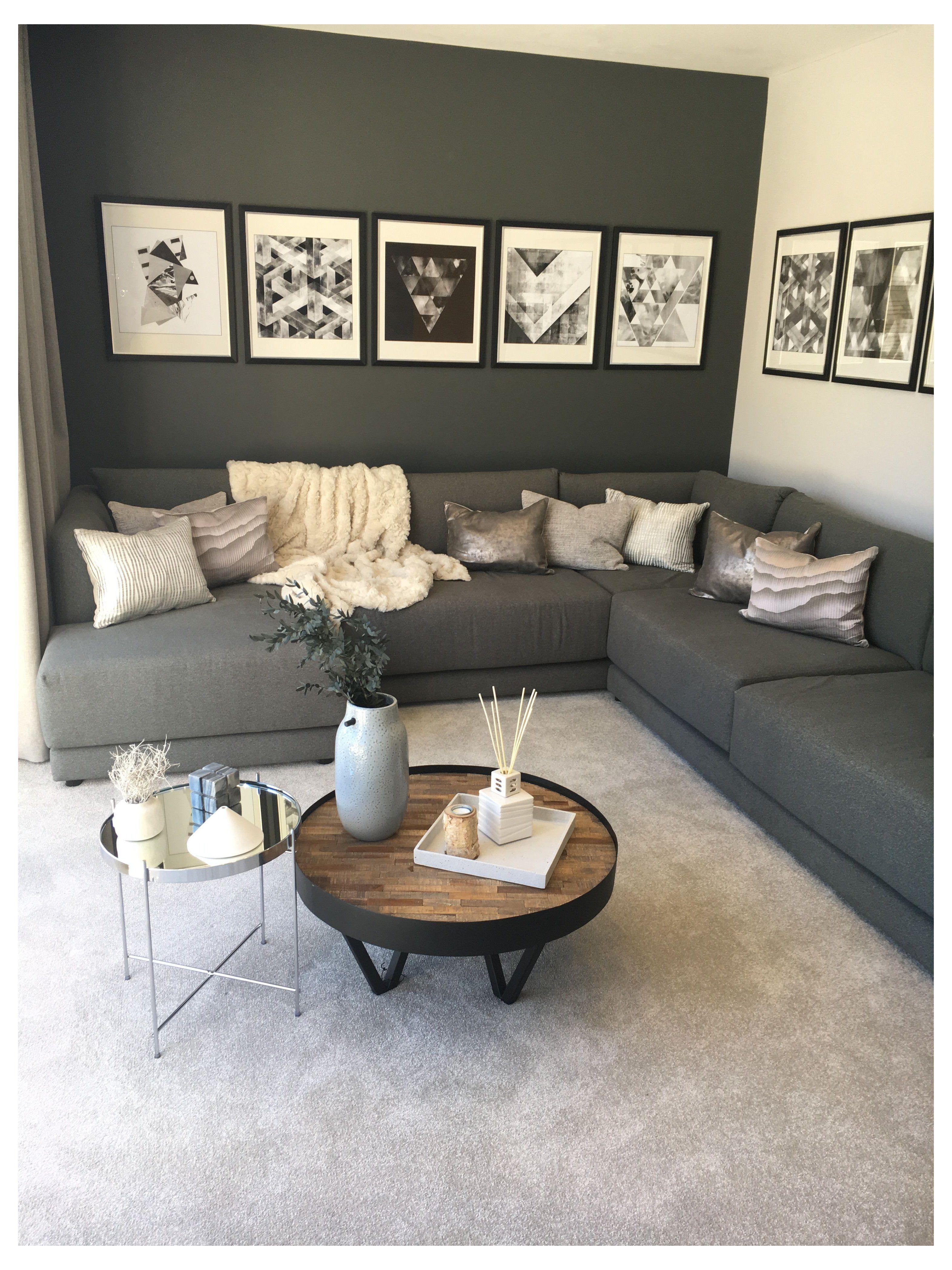 Strata Intrigue Lounge Decor Grey Walls A Dark Grey Contrast Wall And Statement Grey Sofa In 2021 Grey Sofa Living Room Black Living Room Living Room Decor Gray Gray couch living room colors