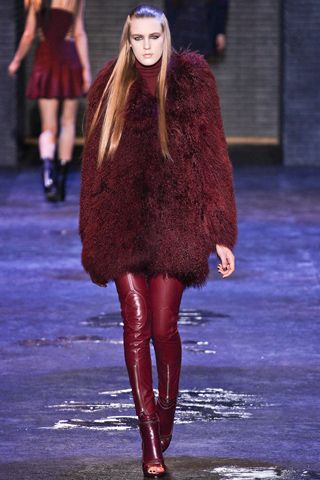 Fluffy fur and leather leggings at Versus