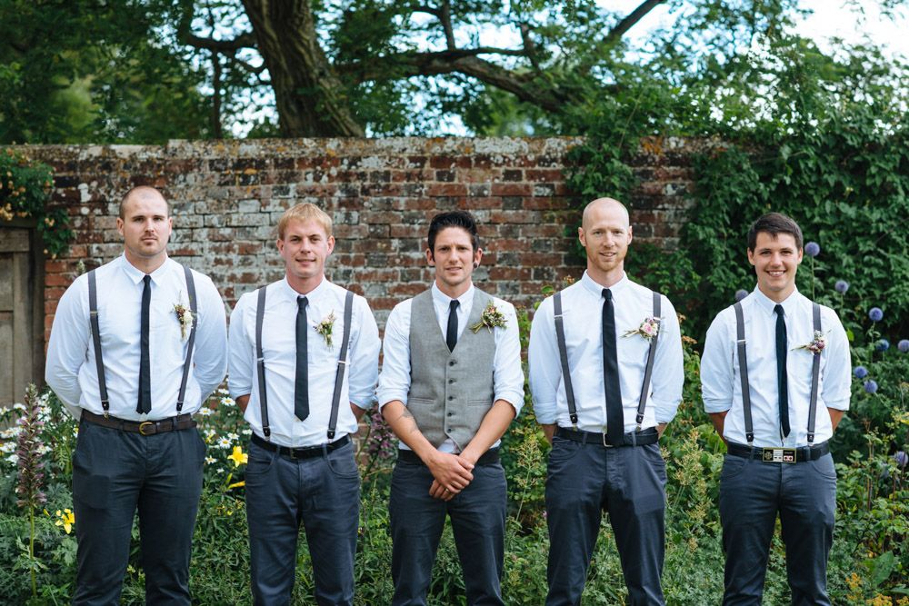 e8c6bae5f1b groom and groomsmen in navy pants and suspenders for casual outdoor I Dos