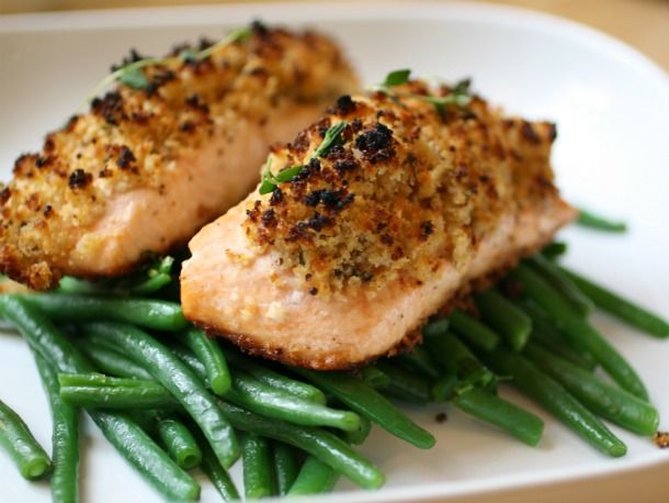 Crunchy Mustard Baked Salmon- super easy and delicious. Used 50 calorie a slice wheat bread and grainy Dijon mustard with some dried thyme. We kept the steamed green beans underneath, and added a salad.