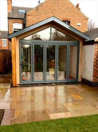Think This Is Stunning Wood Glass Above The Bi Folding Doors Overhang Small House Extensions House Extension Design Garden Room Extensions